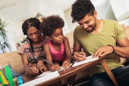 107132886--mom-and-dad-drawing-with-their-daughter-african-american-family-spending-time-together-at-home-